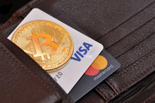 Rome, Italy, August 18, 2018. Bitcoin Gold Coin And Debit Cards Visa And MasterCard In A Wallet Leather