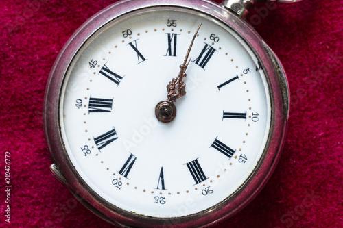 retro pocket watch on red velvet close up