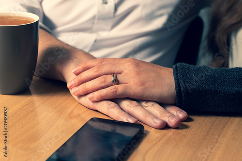 Fotografia  The female hand caresses a male hand.