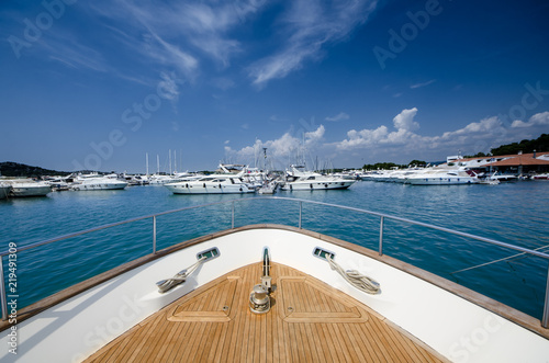 Wide angle shot of front of the yacht in martina on clear summer day