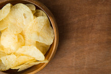 Top View Of Potato Chips In Wo...