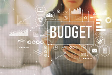 Budget With Woman Using Her Sm...