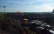 Digging a dam on a farm, with a bulldozer