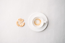 Empty Coffee Cup After Drink And Crispy Snack On White Background, Trendy Minimal Monochrome Concept, Lazy Sleepy Morning Closeup