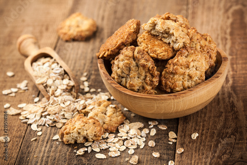 Foto op Canvas Koekjes Homemade oatmeal cookies and oat flakes