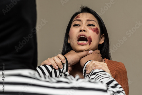 Fotografie, Obraz  Thief strangle woman in bedroom,Crime and violence concept