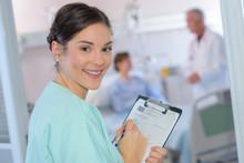 Smiling Nurse Holding Clipboard
