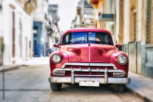 Old classic car in Habana city with blur effect Canvas Print