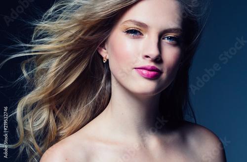 Beautiful blonde woman with pink lipstick beauty model