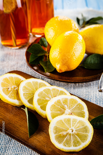 lemons-on-cutting-board-on-wooden-table