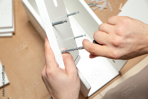 Valokuva  Assembling of furniture, closeup of tool in hand