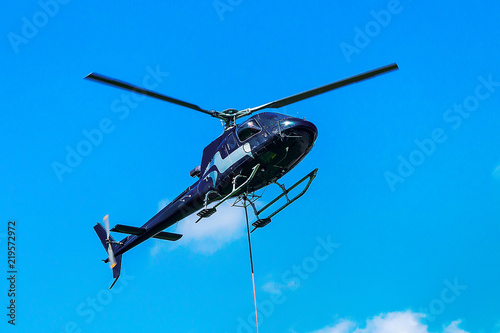 Tuinposter Helicopter Helicopter flying sky in Lavaux Switzerland