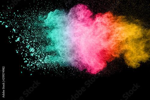 Fotobehang Heelal Multicolored powder explosion on black background.