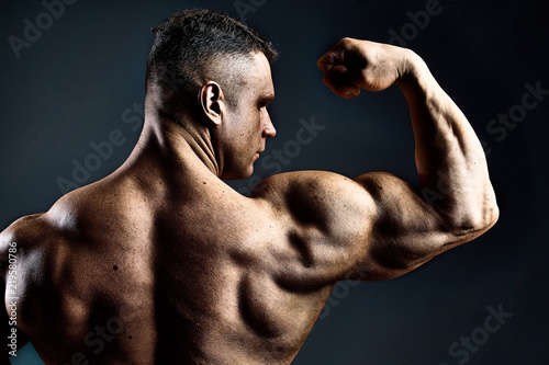 powerful man show his biceps