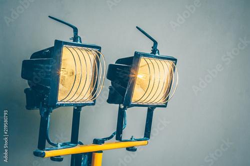 Obraz Finishing works - Double construction halogen spotlight for painting works - fototapety do salonu