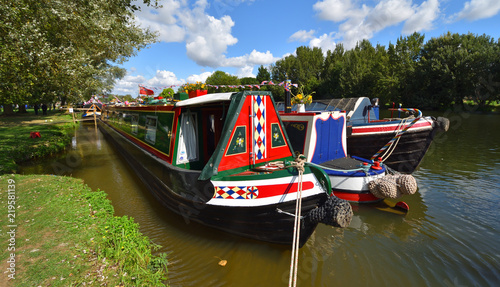 Decorated Narrow Boat moored on the river