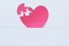 Top View Image Of Paper Pink Heart Puzzle With Missing Piece Over White Background. Health Care, Donate, World Heart Day And World Health Day Concept.