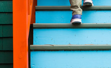 Walking Up Stairs On A Colorful House