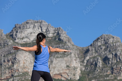 Fotografie, Obraz  Active Young Woman Doing Yoga with Mountains in Background