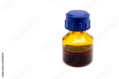 Fotografía  Dark bottle with medicine isolated on white background.