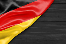 Flag Germany And Space For Text On A Dark Wooden Background