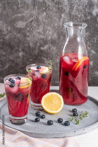 Fresh blueberry summer mojito cocktail. Blueberry lemonade or sangria on kitchen countertop.