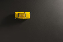 Yellow Toy Taxi Car On A Black Background.