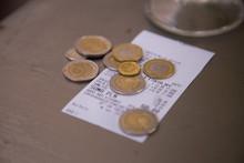 Polish Currency Waiter Tips On A Restaurant Receipt. Zloty.