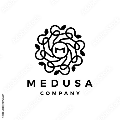 Photo M letter medusa gorgona logo vector icon illustration