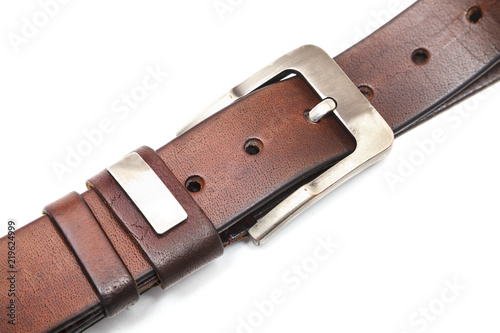Fotografía  leather strap with metal buckle close - up isolated on white background
