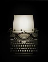 Ancient Typewriter Against Black Background In Dark Ambiance