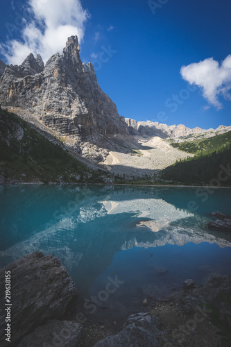 Wall Murals Northern Europe Amazing view of Sorapis lake with unusual color of water. Lake located in Dolomite Alps, Italy