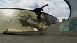 Guy riding on a skateboard and performs tricks slow motion