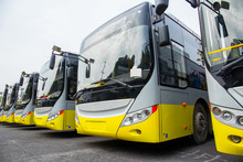 New Electric Bus Parked In Open-air Parking Lot
