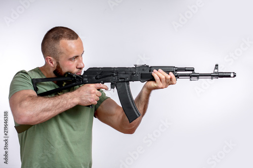 Valokuva  Bearded manful guy of european appearance in casual clothing with sniper rifle a