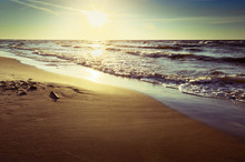 Baltic Sea Coast With Waves Breaking On The Beach At Sunset. Scenic Picturesque Summer Seascape. Stegna, Pomerania, Northern Poland.