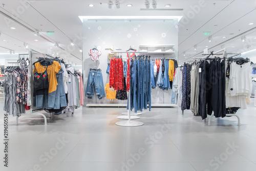 Fotomural  Various shop clothing in ladies' clothing store in summer