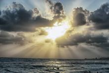 Sun Beams Trough The Clouds In...