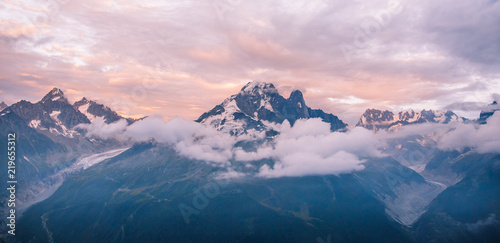 Poster Lichtroze Cloudy Sunset over Iconic Mont-Blanc Mountains Range and Glaciers.