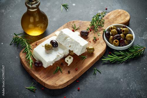 Fototapeta Greek cheese feta with thyme, rosemary and olives obraz