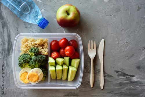 Fotobehang Assortiment Lunch box with healthy food