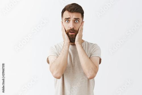 Fotomural Portrait of handsome stylish male entrepreneur starting panic looking concerned