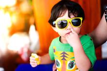 Asian Child Baby Boy Wearing Yellow Sunglasses