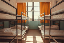 Window In Bedroom Of A Youth Hostel With Clean Beds For Relaxing Tourists And Students