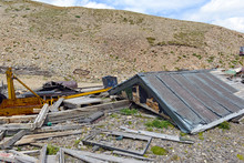 Remains Of Old Mine And Vintage Mining Log Cabin In The Mountains In The Western USA Reflective Of The Pioneers From Another Generation