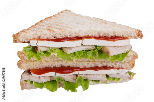 sandwich with mozzarella cheese or feta with chicken meat, lettuce leaves and with ketchup, on toasted bread, isolate, on white background