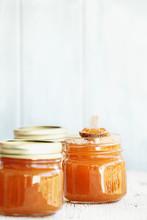A Row Of Mason Jars Full Of Ho...
