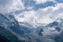Dome And Aiguille Du Gouter Mountain Peaks With Bossons Glacier In The European Alps, A Summer Snowy Landscape.