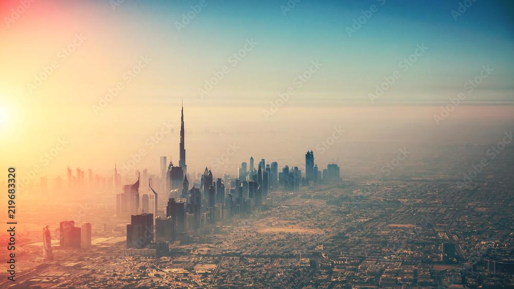 Fototapeta Aerial view of Dubai city in sunset light