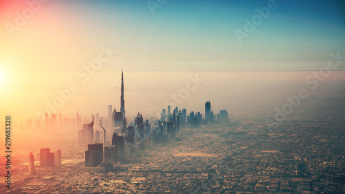 Aerial view of Dubai city in sunset light Fotobehang